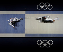 Italy's Elisa Di Francisca faces South Korea's Nam Hyun-hee during a semifinal fencing match at the 2012 Summer Olympics, Saturday, July 28, 2012, in London. (AP Photo/Morry Gash)