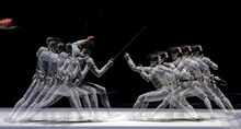 This multiple exposure photo shows Italy's Elisa Di Francisca, left, and Korea's Nam Hyun Hee competing during a semifinal fencing match at the 2012 Summer Olympics, Saturday, July 28, 2012, in London. (AP Photo/Andrew Medichini)
