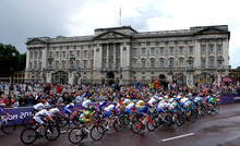 Cyclists make their way past Buckingham Palace in London during the women's road cycling race at the 2012 Summer Olympics on Sunday July 29, 2012. (AP Photo/Dave Thompson, PA) UNITED KINGDOM OUT; NO SALES; NO ARCHIVE