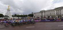 Cyclists pass Buckingham Palace during the women's road cycling race at the 2012 Summer Olympics, Sunday, July 29, 2012, in London. (AP Photo/Matt Rourke)