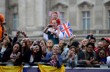 Fans watch as the cyclists approach their position during the Women's Road Race for the London 2012 Olympics in London, England on Sunday, July 29, 2012.  (Nhat V. Meyer/Mercury News)