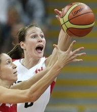 (AP Photo) Former Utah women's basketball player Kim Smith scored 20 points for Canada, but it was not enough to defeat Russia in the opening of women's Olympic basketball.