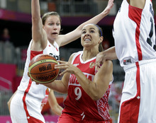 (AP Photo) Former Utah women's basketball player Kim Smith (left) scored 20 points for Canada, but it was not enough to defeat Russia in the opening of women's Olympic basketball.