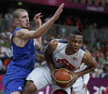 USA's Russell Westbrook, right, is defended by France's Nando de Colo during the first half of a preliminary men's basketball game at the 2012 Summer Olympics, Friday, July 27, 2012, in London. (AP Photo/Charles Krupa)