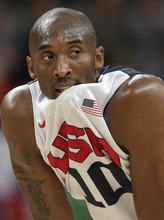 USA's Kobe Bryant bites his jersey during the first half of a preliminary men's basketball game against France at the 2012 Summer Olympics, Friday, July 27, 2012, in London. (AP Photo/Charles Krupa)