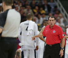 USA's coach Michael Krzyzewski makes a point during the first half of a preliminary men's basketball game against France at the 2012 Summer Olympics, Sunday, July 29, 2012, in London. (AP Photo/Charles Krupa)