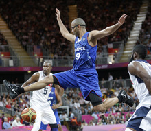 France's Tony Parker is stripped of the basketball by USA's James Harden, right,  during the first half of a preliminary men's basketball game at the 2012 Summer Olympics, Friday, July 27, 2012, in London. (AP Photo/Eric Gay)