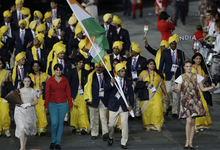 India's Sushil Kumar carries the flag during the Opening Ceremony at the 2012 Summer Olympics, Friday, July 27, 2012, in London. (AP Photo/Mark Humphrey)