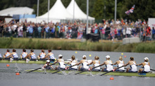 U.S. rowers, left to right in foreground, Mary Whipple, Caryn Davies, Caroline Lind, Eleanor Logan, Meghan Musnicki, Taylor Ritzel, Esther Lofgren, Zsuzsanna (AP Photo/Chris Carlson) Francia, and Erin Cafaro stroke during a women's rowing eight heat in Eton Dorney, near Windsor, England, at the 2012 Summer Olympics, Sunday, July 29, 2012. Great Britain's boat is at rear.