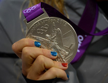Elizabeth Beisel shows off her silver medal after placing second in the Women's 400m Individual Medley at the Aquatics Centre in London, England on Saturday, July 28, 2012.  (Nhat V. Meyer/Mercury News)