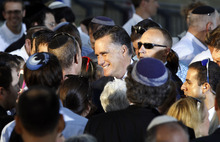 Republican presidential candidate and former Massachusetts Gov. Mitt Romney greets audience members after he delivered a speech in Jerusalem, Sunday, July 29, 2012. (AP Photo/Charles Dharapak)