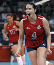 United States' Lindsey Berg, right, and teammate Logan Tom, left, celebrate during a women's preliminary volleyball match against Brazil at the 2012 Summer Olympics, Monday, July 30, 2012, in London. (AP Photo/Jeff Roberson)