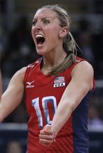 United States' Jordan Larson celebrates during a women's preliminary volleyball match against Brazil at the 2012 Summer Olympics, Monday, July 30, 2012, in London. (AP Photo/Jeff Roberson)