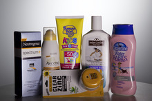 FILE - In this May 26, 2010 file photo, various sunscreen products are seen in Washington.  When the Obama administration agreed to set the first-ever federal limits on runoff in Florida, environmental groups thought the state's waters would finally get clean from a nutrient overdose that spawns algal blooms, suffocates rivers, lakes and streams, and forms byproducts in drinking water that could make people sick. The Florida rule is one of a string of regulations delayed at federal agencies, or at the White House office responsible for reviewing new rules. Together, they highlight the administration's cautiousness in an election year, where it has been increasingly under attack by Republicans and business groups for favoring big government and costly regulations that they allege kill jobs.  (AP Photo/Evan Vucci, File)