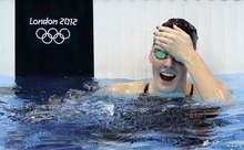 United States' Missy Franklin reacts to her gold medal win in the women's 100-meter backstroke swimming final at the Aquatics Centre in the Olympic Park during the 2012 Summer Olympics in London, Monday, July 30, 2012. (AP Photo/Lee Jin-man)