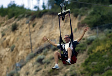 Kim Raff  |  The Salt Lake Tribune Chris Palme goes down the Extreme Zipline during the London Summer Olympics celebration at Utah Olympic Park in Park City, Utah on July 28, 2012.