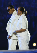 Boxer Muhammad Ali, left, and his wife Yolonda Williams participate in the Opening Ceremony at  the 2012 Summer Olympics, Saturday, July 28, 2012, in London. (AP Photo/Cameron Spencer, Pool)