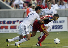 (The Salt Lake Tribune, Kim Raff) Real Salt Lake's Alvaro Saborio, right, shields the ball from Vancouver Whitecaps' Martin Bonjour during an MLS soccer game Friday at Rio Tinto Stadium. RSL opens CONCACAF Champions League play today at 8 p.m. (MDT).