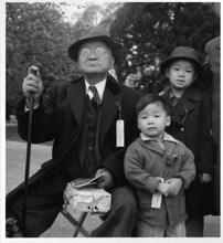 An older Japanese American and his grandchildren in California awaiting relocation.  Courtesy Topaz Collection, Utah State Historical Society.