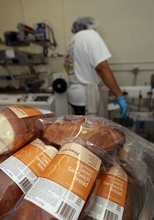 In this Thursday, July 14, 2012 photo, a worker packages gluten-free bread at Pure Knead bakery sandwich bread in Decatur, Ga. A decade ago, virtually no one in the United States seemed to have a problem eating gluten in bread and other foods. Now, millions do and spend more than $7 billion on gluten-free products. Yet, experts estimate that more than half of those consumers don't have any clear-cut reaction to gluten. (AP Photo/John Bazemore)