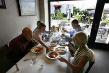 Scott Sommerdorf  |  The Salt Lake Tribune              The family table at Per Noi Trattoria, Friday, July 20, 2012.