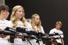 Trent Nelson  |  The Salt Lake Tribune Kelsey Keel, Cassie Wood, Bridnee Blackburn and Brian Robinson are introduced to their weapons during a simulation at Freedom Academy, at Camp Williams, Utah on Tuesday, July 31, 2012.