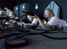 Trent Nelson  |  The Salt Lake Tribune Adriana Higley, right, takes aim with a rifle in the weapon simulator during activities at Freedom Academy, at Camp Williams, Utah on Tuesday, July 31, 2012. At center is Brianna McPhail, left is Bridnee Blackburn.
