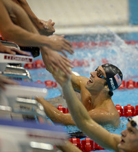United States' Michael Phelps, right, celebrates after winning gold in the men's 4x200-meter freestyle relay swimming final at the Aquatics Centre in the Olympic Park during the 2012 Summer Olympics in London, Tuesday, July 31, 2012. (AP Photo/Mark J. Terrill)