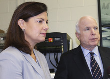 U.S. Sen. Kelly Ayotte, R-N.H., left, listens as Sen. John McCain, R-Ariz., speaks to the media after a town hall meeting Tuesday, July 31, 2012 in Merrimack, N.H. Tuesday's town hall meeting in Merrimack was the final stop on McCain's two-day tour designed to sound the alarm about the automatic, across-the-board cuts that are part of a $1.2 trillion deficit-cutting plan. (AP Photo/Holly Ramer)