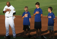 Steve Griffin | The Salt Lake Tribune   Members of a Lehi, Utah junior baseball team stand with Bees infielder Luis Jimenez during the National Anthem before game between the Bees and the New Orleans Zephyrs at Spring Mobile Ballpark in Salt Lake City, Utah Wednesday August 1, 2012. The younger players got to take the field with the big league players during introductions.