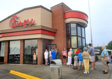 Customers line up outside the Chick-fil-A Restaurant at New Bern Mall on Wednesday, Aug. 1, 2012 in New Bern, N.C.  Supporters of Chick-fil-A are planning to eat at restaurants in the chicken chain as the company continues to be criticized for an executive's comments about gay marriage. Former Arkansas Gov. Mike Huckabee, a Baptist minister, declared Wednesday national