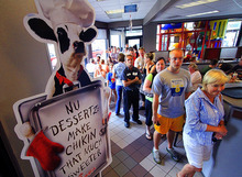 Customers stand in a long line at the Chick-fil-A  in Columbus, Ga., Wednesday, Aug. 1, 2012. Chick-fil-A supporters are eating at restaurants in the chicken chain as the company continues to be criticized for an executive's comments about marriage and family. (AP Photo/The Ledger-Enquirer, Mike Haskey)