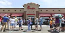 Customers stand in line for a Chick-fil-a meal at the chain's restaurant in Wichita, Kan., on Wednesday. Aug. 1, 2012. The crowd was buying meals to show their support for the company that's currently embroiled in a controversy over same-sex marriage.   Former Arkansas Gov. Mike Huckabee, a Baptist minister, declared Wednesday national