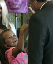 Rick Egan    The Salt Lake Tribune   Second Grader, Sydnee Hall high-five's Gov. Herbert after he read to the second grade students at Foxboro Elementary, in North Salt Lake, Tuesday, July 31, 2012.  Gov. Herbert and leaders of Prosperity 2020 announced an initiative to get more business volunteers in schools.