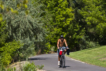 Chris Detrick  |  The Salt Lake Tribune A cyclist bikes Wednesday on the Jordan River Parkway Trail near Oxbow Park.  A complete map of the trail system has been designed and printed with the assistance of the National Park Service Rivers and Trails Conservation Assistance (RTCA) Program.