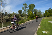 Chris Detrick  |  The Salt Lake Tribune Cyclists bike Wednesday on the Jordan River Parkway Trail near Oxbow Park.  A complete map of the trail system has been released and is now available to the public.