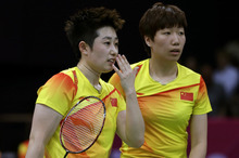 (AP Photo/Andres Leighton) China's Yu Yang, left, and Wang Xiaoli talk while playing against Jung Kyun-eun and Kim Ha-na, of South Korea, in a women's doubles badminton match at the 2012 Summer Olympics, Tuesday, July 31, 2012, in London. World doubles champions Wang and Yu, and their South Korean opponents were booed loudly at the Olympics on Tuesday for appearing to try and lose their group match to earn an easier draw.