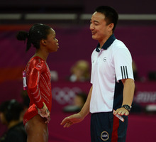 USA's Gabby Douglas chats with coach Liang Chow before she competed on the floor exercise for the Women's Gymnastics Team finals at North Greenwich Arena for the London 2012 Olympics in London, England on Tuesday, July 31, 2012.  (Nhat V. Meyer/Mercury News)