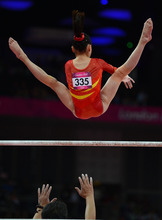 China's Jinnan Yao gets a spot during her uneven bars routine for the Women's Gymnastics Team finals at North Greenwich Arena for the London 2012 Olympics in London, England on Tuesday, July 31, 2012.  (Nhat V. Meyer/Mercury News)