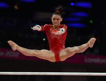 USA's Kyla Ross competes in the uneven bars for the Women's Gymnastics Team finals at North Greenwich Arena for the London 2012 Olympics in London, England on Tuesday, July 31, 2012.  (Nhat V. Meyer/Mercury News)