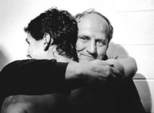 Coach Lavell Edwards gives Mark Bellini a hug after BYU's victory over Michigan in the 1984 Holiday Bowl in Jack Murphy Stadium in San Diego.  photo by RIck Egan 12/21/1984