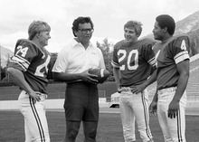 Coach Norm Chow with Bill Ring (24), Scott Phillips (20) and  Casey Wingard (4) are pictured in this 1978 photo. Mark Philbrick/BYU