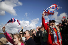 Fans waving British flags cheer at the rowing venue in Eton Dorney, near Windsor, England, at the 2012 Summer Olympics, Monday, July 30, 2012. (AP Photo/Natacha Pisarenko)