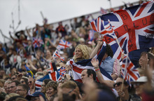 British fans cheer for their team at the show-jumping phase of the equestrian eventing competition at the 2012 Summer Olympics, Tuesday, July 31, 2012, at Greenwich Park in London. (AP Photo/David Goldman)