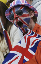 A volley ball fan cheers after Great Britain defeated Canada during a beach volleyball match at the 2012 Summer Olympics, Sunday, July 29, 2012, in London. (AP Photo/Dave Martin)