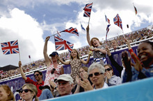 Fans cheer for Mary King, of Great Britain, as she competes with her horse Imperial Cavalier in the equestrian eventing dressage phase at the 2012 Summer Olympics, Saturday, July 28, 2012, in London. (AP Photo/David Goldman)