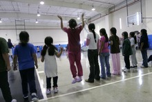 Children are shown participating in physical education at the T. Don Hutto Residential Center in Taylor, Texas, in April 2008, during a tour for the media. The U.S. is locking up more illegal immigrants than ever before, generating a lucrative business for the nation's largest prison companies.  (AP Photo/Donna McWilliam, Pool, File)
