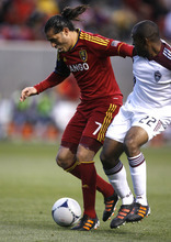 Rick Egan  | The Salt Lake Tribune   Real Salt Lake's Fabian Espindola (7)  controls the ball, as Colorado Rapids Marvell Wynn defends, in RSL action, Real Salt Lake vs. Colorado Rapids at Rio Tinto Stadium, Saturday, April 7, 2012.