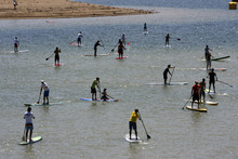 Francisco Kjolseth  |  The Salt Lake Tribune Dozens of stand up paddle boarders take to the water for the Open Air Demo Day kicking off the Outdoor Retailer Summer Market at Jordanelle State Park on Wednesday, August 1, 2012. More than 150 outdoor brands and many more retailers are at the reservoir to show off and experience first-hand the new gear coming out for the summer of 2013. More than 27,000 are expected to attend the twice a year convention held at the Salt Palace Convention Center which runs Aug. 2-5.