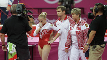 Russian gymnast Kseniia Afanaseva walks dejected after falling during her floor exercise during the Artistic Gymnastics women's team final at the 2012 Summer Olympics, Tuesday, July 31, 2012, in London. (AP Photo/Julie Jacobson)